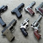 Clockwise starting at topleft:  Glock G22, Glock G21, Kimber Custom Raptor, Dan Wesson Commander, Smith & Wesson Air Weight .357, Ruger Blackhawk .357, Ruger SP101, Sig Sauer P220 Combat.